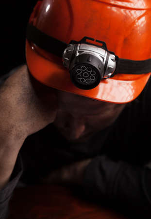 Coal miner on a black background Stock Photo