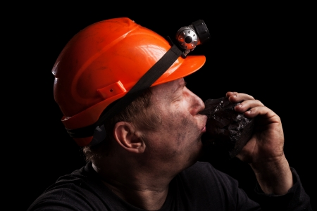Coal miner on a black background photo