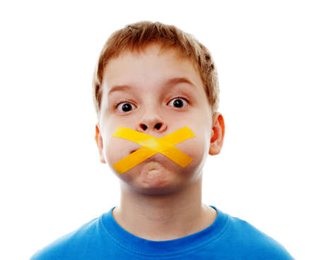 silenced: Sad  boy with silenced with tape   Stock Photo