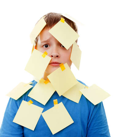 multitask: boy with memo posts on his face  on a white background Stock Photo