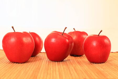 Red apples on a light background closeup Stock Photo