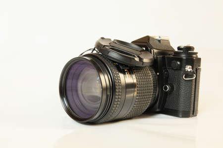 Film camera in black on a light background closeup