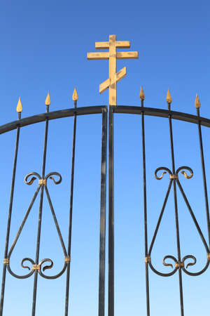 The iron gate to the monastery against the blue sky close-up Stock Photo - 13284212