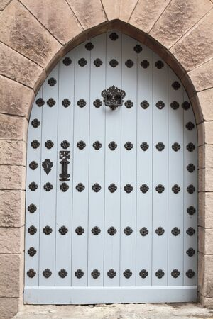 The iron door into the stone wall of grey color close-up Stock Photo - 17018408