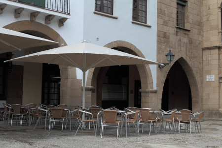 The outdoor cafe in the Catalan village on the background of stone Stock Photo - 17004861