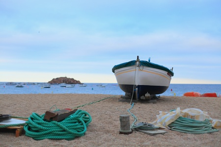 Boat on the shore of the Mediterranean sea in Catalonia closeup Stock Photo - 17004869