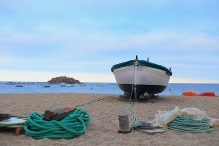 Boat on the shore of the Mediterranean sea in Catalonia closeup Stock Photo - 17004869