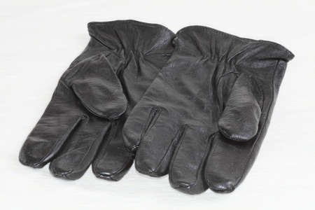 Gloves leather black closeup on a light background  photo