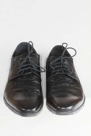 Men s boots of black colour closeup on a light background Stock Photo - 17912206