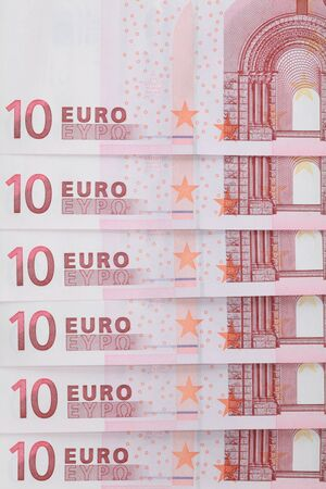 Banknotes in denominations of 10 Euro closeup on a light background. photo