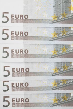 Notes in denominations of 5 euros closeup on a light background. photo