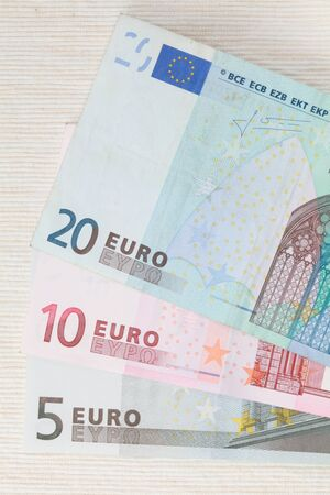 Notes in denominations of 5, 10 and 20 Euro closeup on a light background. photo