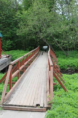 The old wooden bridge across the river, where stith construction cart