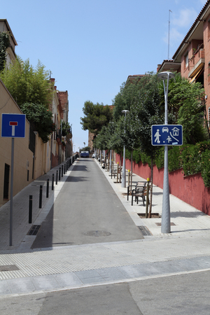 Street in Barcelona on a sunny summer day closeup very narrow and completely deserted. photo