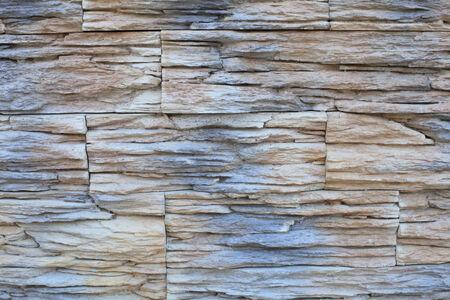 Stone wall of dark shades closeup natural illumination in the spring day