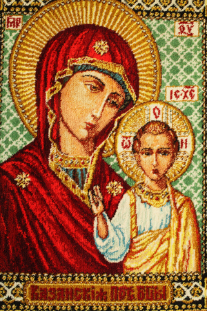 Carpet with the image of the Orthodox icon closeup natural bright light. Stock Photo