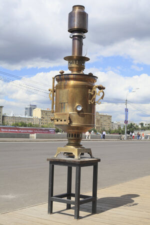 Samovar copper closeup on background Moskva River embankment in the park Gorky sunny June day.