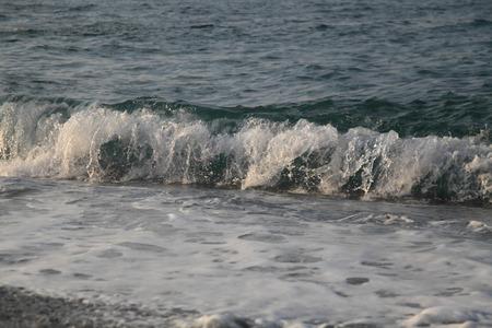 Bubble waves on the Black Sea near the shore close-up daylight Stock Photo