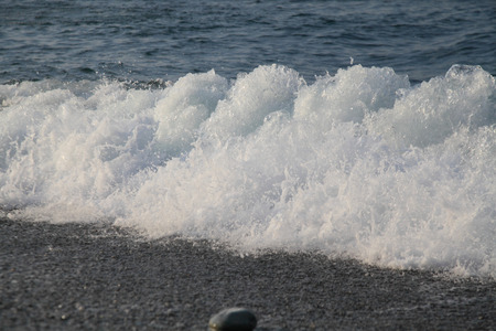 Bubble waves on the Black Sea near the shore close-up daylight Stock Photo