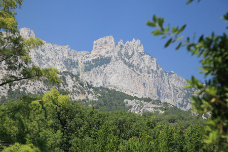 Mount Ai-Petri on a background of blue sky in the bright daylight of Sunny summer day.