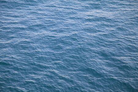 A small wave of the Black Sea deep blue close poanom daylight.