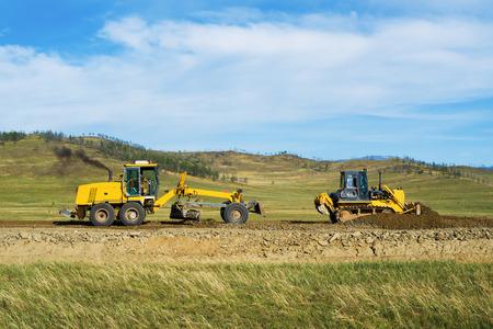 grader: Grader and bulldozer on road construction