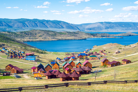 Beautiful views of the tourist base and the Curkut Bay in August. Lake Baikal, Russia