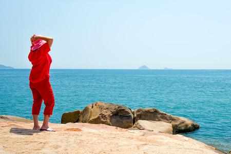 hon: Woman looking at the sea Stock Photo