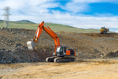 Excavator and bulldozer build a new road
