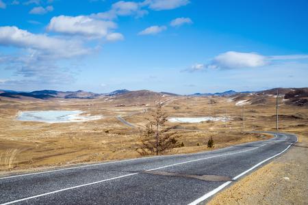 The road to Lake Baikal in March. Frozen salt lakes. Irkutsk region, Siberia, Russia.