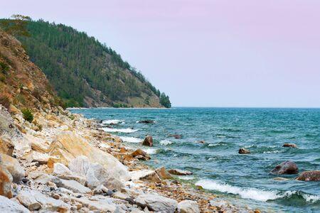 The stony shore of Lake Baikal in summer. Wildlife of Siberia, Russia. Фото со стока