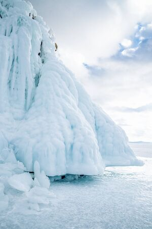 A huge block of ice hanging over the surface of Lake Baikal. Siberia, Russia.
