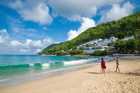 Two girls on Nai Harn beach - one of the most beautiful beaches of Phuket, Thailand.