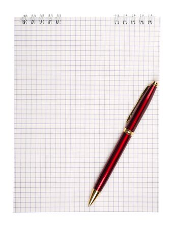 Spiral notepad with squared paper and pen isolated on white.