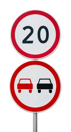 Speed limit sign 20 and no overtaking road sign on a metal pole isolated on white.