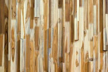 Decorative wall made of wood waste. Фото со стока