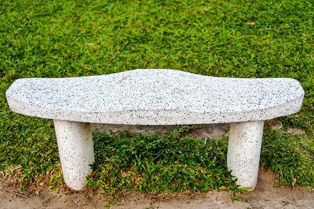 Park bench made of concrete Фото со стока