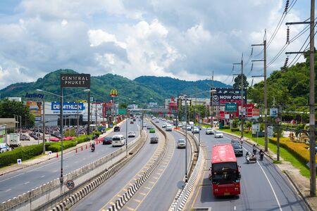 Phuket island, Thailand - June 1, 2019: traffic on Chao Fah Tavan Tok road near Central Festival Phuket. View from the elevated pedestrian crossing. Редакционное