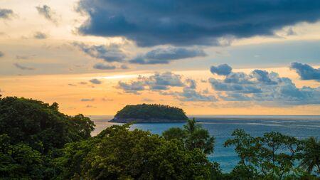 Beautiful view of the sea, sunset and Pu island in the evening. Phuket island, Thailand. Фото со стока
