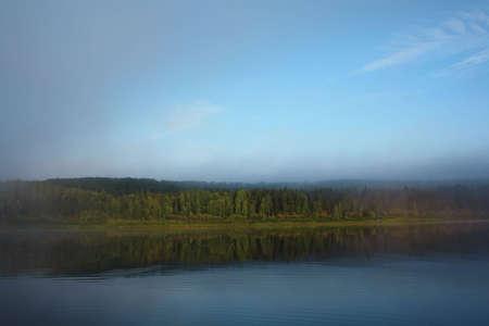 Foggy river bank photo