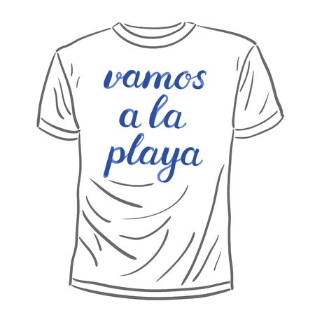 let s: Vamos a la playa. Let s go to the beach in Spanish. Brush hand lettering on a sample t-shirt. Great for beach tote bags, swimwear, holiday clothes, and more. Illustration