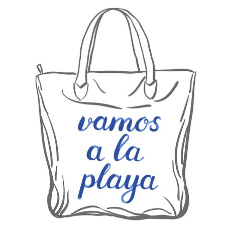 let s: Vamos a la playa. Let s go to the beach in Spanish. Brush hand lettering on a sample tote bag. Great for beach tote bags, swimwear, holiday clothes, and more.