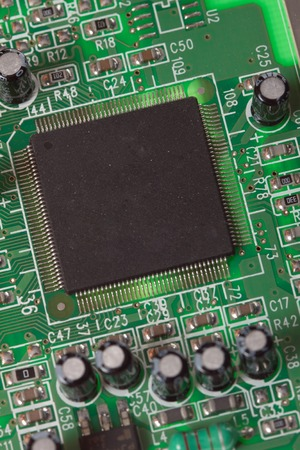 processors: computer processor on green board, photo. Central Computer Processors CPU concept. Foto of macro view central processor unit on mainboard with shine lines