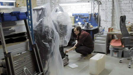 Factory for the production of robots. The engineer examines the robot. Creates a new robot in the lab. Repairs robot parts