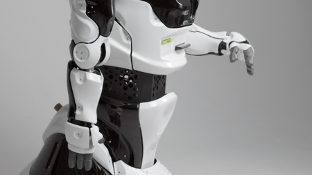 Modern Robotic Technologies. Modern robot in a bright studio. Android raises and bends a hand on a white background. Waving a palm, looks at the camera