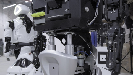 Factory for the production of robots, modern robotic developments. Overview of the new disassembled robot in the workshop