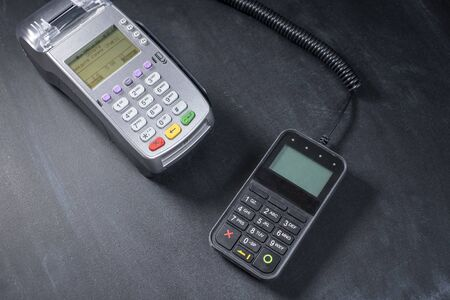 Bank terminal for non-cash payment by mobile phone or credit card