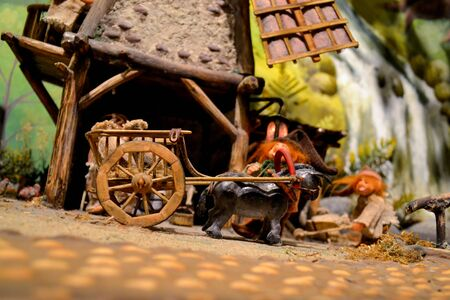 house donkey: Toy black donkey pulls the cart to the owner of the house. Stock Photo