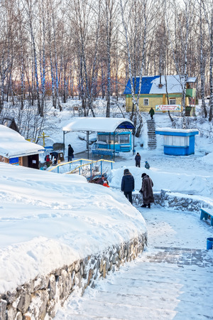 Russia, Siberia, Novosibirsk region, Iskitimsy district, village Loghok - January 6, 2016: The natural source of fresh drinking water, a holy spring, a place of pilgrimage Siberians Editorial