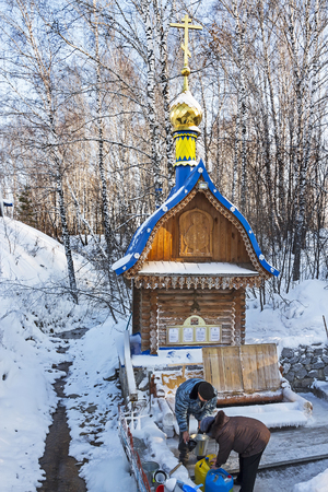 Russia, Siberia, Novosibirsk region, Iskitimsy district, village Loghok - January 6, 2016: The natural source of fresh drinking water, a holy spring, a place of pilgrimage Siberians